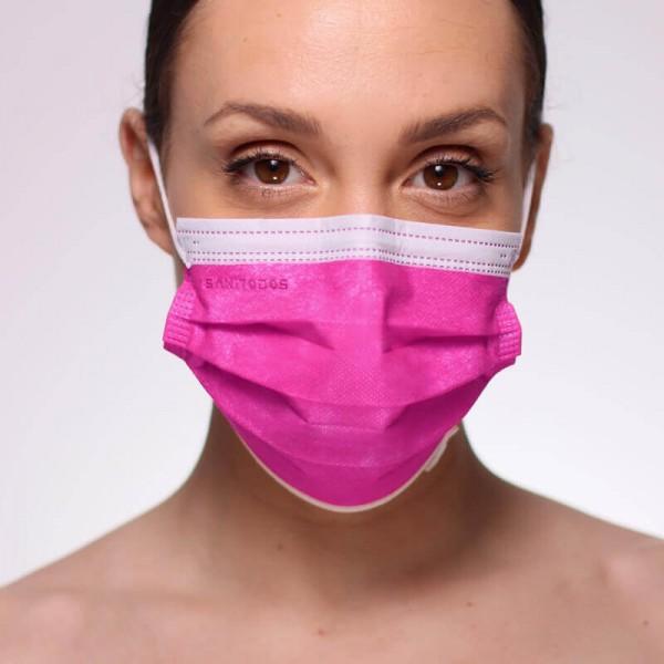 La modelo de la fotografía lleva una mascarilla quirúrgica gris oscuro de tipo IIR.