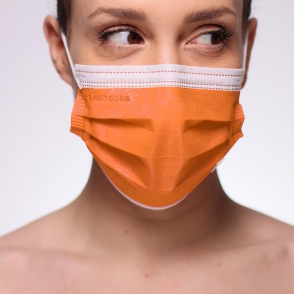 La siguiente fotografía muestra una caja de mascarillas azul marino sin composición de grafeno para su fabricación.